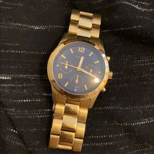 Guess Gold chain and navy blue face watch